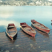 Wooden boats on picture perfect lake Bled, Slovenia. — Stock Photo