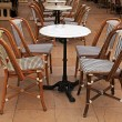 French outdoor cafe with small round tables and chairs — Stock Photo #70193499