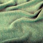 Green crumpled luxury cashmere background — Stock Photo #72818051