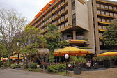 Hotel and outdoor cafe on promenade of Montreux, Switzerland. — Stock Photo
