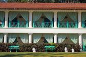 Facade of summer resort villa with balconies in scenary garden — Stock Photo
