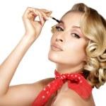 Постер, плакат: Closeup beautiful woman with eyebrow brush tool