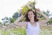 Girl in a wreath of field-flowers — Stock Photo