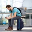 Traveler sitting sending text message — Stock Photo #51896021