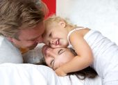 Loving mother and father smiling with young child — Stock Photo
