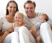 Happy family smiling at home with children — Stock Photo