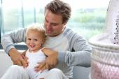 Happy father playing with baby daughter — Stock Photo