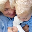 Joyful grandmother holding baby girl — Stock Photo #53241087
