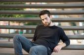Cool guy sitting on steps outdoors — Stock Photo