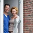 Couple standing by door of new home holding keys — Stock Photo #53523837