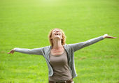 Carefree older woman smiling with arms open — Stock Photo