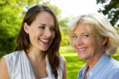 Senior mother smiling with older daughter  — Stock Photo
