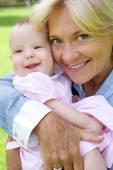 Grandmother and grandchild smiling — Stock Photo