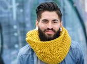 Smiling man with wool scarf — Stock Photo