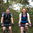 Man and woman cyclist smiling outdoors — Stock Photo #54302433