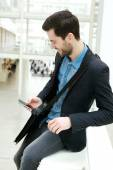 Young man text messaging — Stock Photo