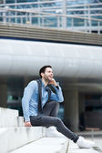 Man sitting outdoors and laughing — Stock Photo