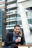 Man smiling and enjoying coffee  — Stock Photo
