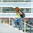 Female student walking on campus — Stock Photo #54457933