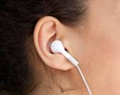 Young woman ear with earphone  — Stock Photo