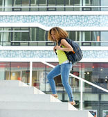 Female student walking on campus — Foto Stock