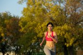 Attractive young woman running outdoors in the park — 图库照片