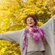 Carefree young african american woman with arms outstretched — Stock Photo #57920987