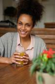 Beautiful woman smiling with glass of orange juice — Stock Photo