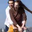 Happy young couple riding bike  — Stock Photo #61418621