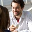 Happy young man drinking coffee with woman — Stock Photo #61418687