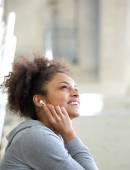 Happy young woman listening to music with earphones — Stock Photo