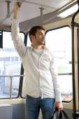 Young man commuting by tram — Stock Photo