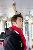 Young man traveling by subway — Stock Photo