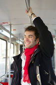 Happy young man traveling by subway — Stock Photo