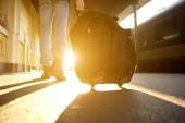Rear view man walking with back at train station — Stock Photo