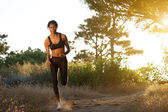Young african american woman jogging in nature — Stock Photo