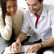Cute happy couple working on laptop — Stock Photo #64594949