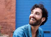 Attractive man with beard laughing — Stock Photo