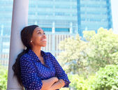 Friendly smiling business woman outside office building — ストック写真