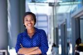 Happy young business woman standing outside office building — Foto de Stock