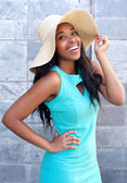 Beautiful african american woman smiling with sun hat — Stock Photo