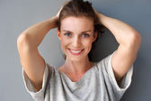 Happy mid adult woman smiling with hands in hair  — Foto de Stock