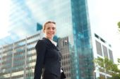 Modern business woman smiling and walking outside  — 图库照片