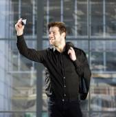 Attractive young modern man taking selfie — Stock Photo