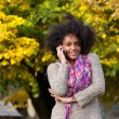 Happy mixed race woman talking on mobile phone outdoors — Stock Photo #73112391