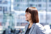 Confident smiling business woman — Stockfoto