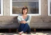 Charming older woman sitting outside — Stock Photo