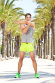 Physical trainer warm up exercise — Stock Photo