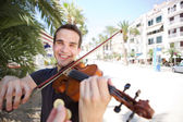 Street performer playing violin being paid money — Stock Photo