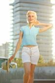 Confident young woman smiling outside in the city — Stock Photo